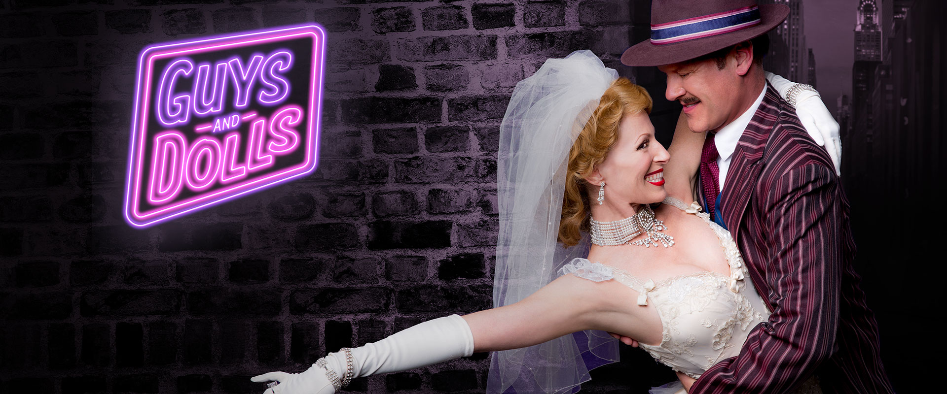 Publicity image from Guys and Dolls linking to the trailer