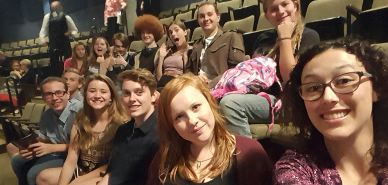 Photo of students waiting for performance to begin.