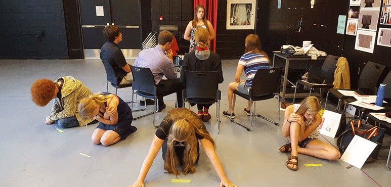 Photo of a pre-show workshop rehearsing tableaux activity.