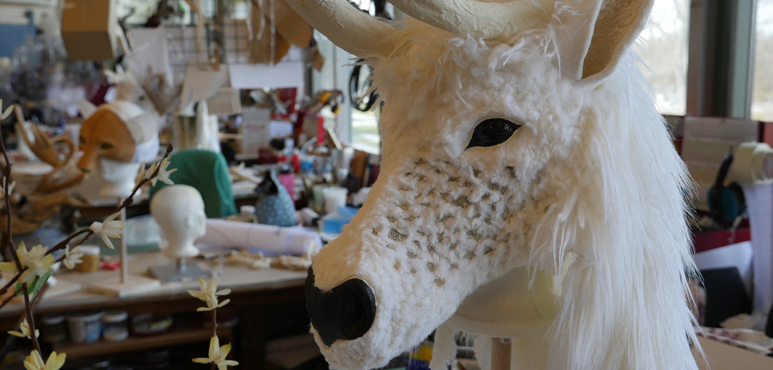 Photograph of a reindeer headpiece in the props department.
