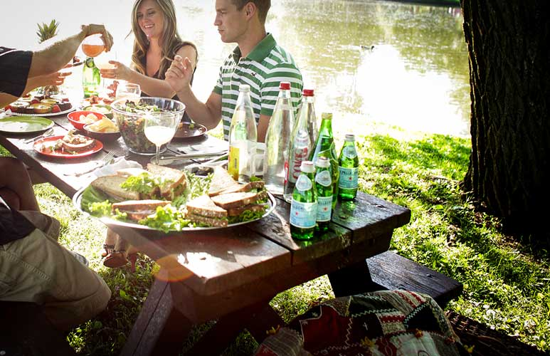 Photograph of patrons enjoying a  picnic by the Avon river