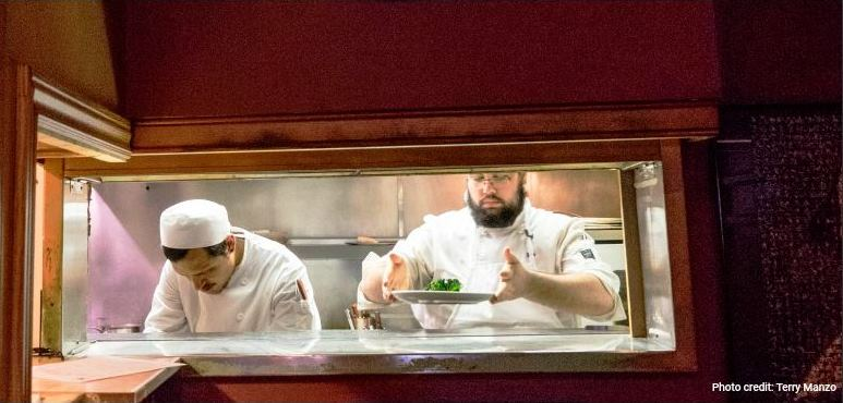 Chefs at the pass. Photo credit by Terry Manzo