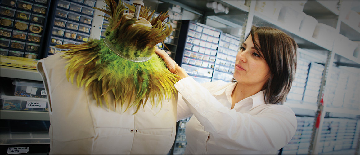 Rebecca Dillow, of the Bijoux Department, works on a costume for <i>Peter Pan</i> (2010).