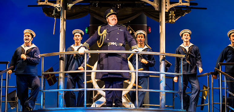 Steve Ross as Captain Corcoran with members of the company. Photography by Cylla von Tiedemann.