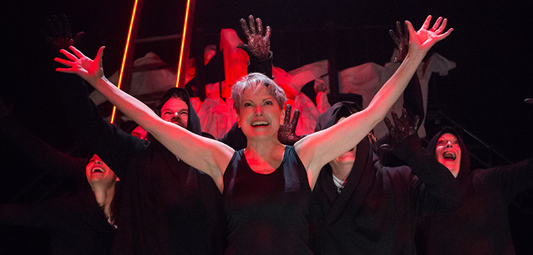 Lucy Peacock as Satan with members of the company. Photography by Cylla von Tiedemann.