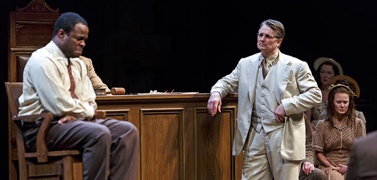 Jonathan Goad as Atticus Finch with members of the company. Photography by David Hou.