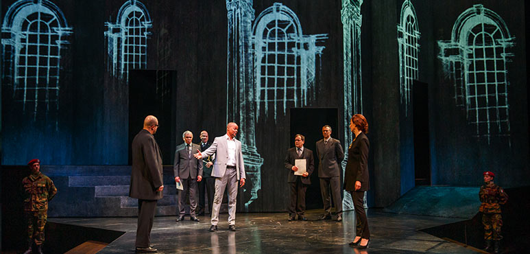 Michael Blake (centre) as Othello with members of the company in Othello. Photography by David Hou.
