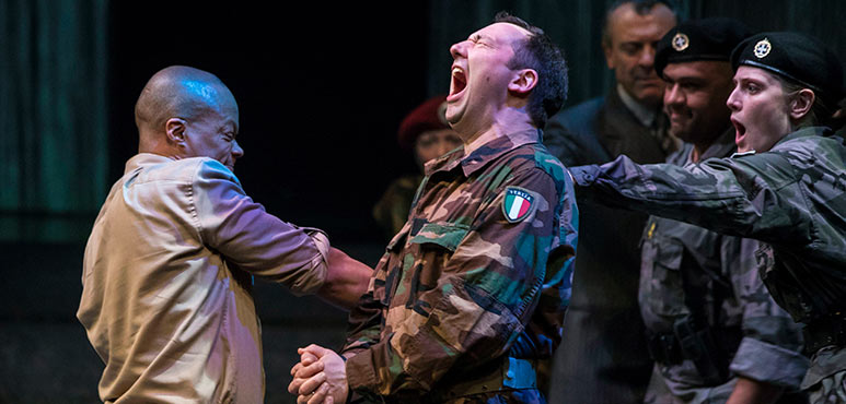 Michael Blake (left) as Othello and Gordon S. Miller as Iago with members of the company in Othello. Photography by Chris Young.