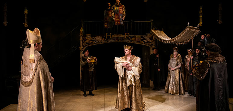 Jonathan Goad (centre) as King Henry VIII with members of the company in Henry VIII. Photography by Emily Cooper.