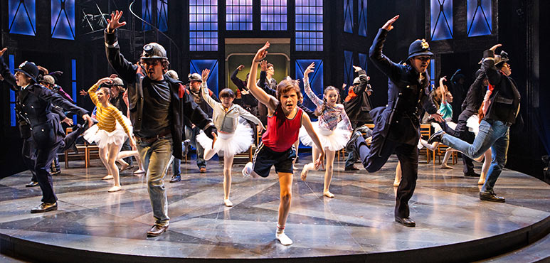 Nolen Dubuc (centre) as Billy Elliot with members of the company in Billy Elliot the Musical. Photography by Cylla von Tiedemann.