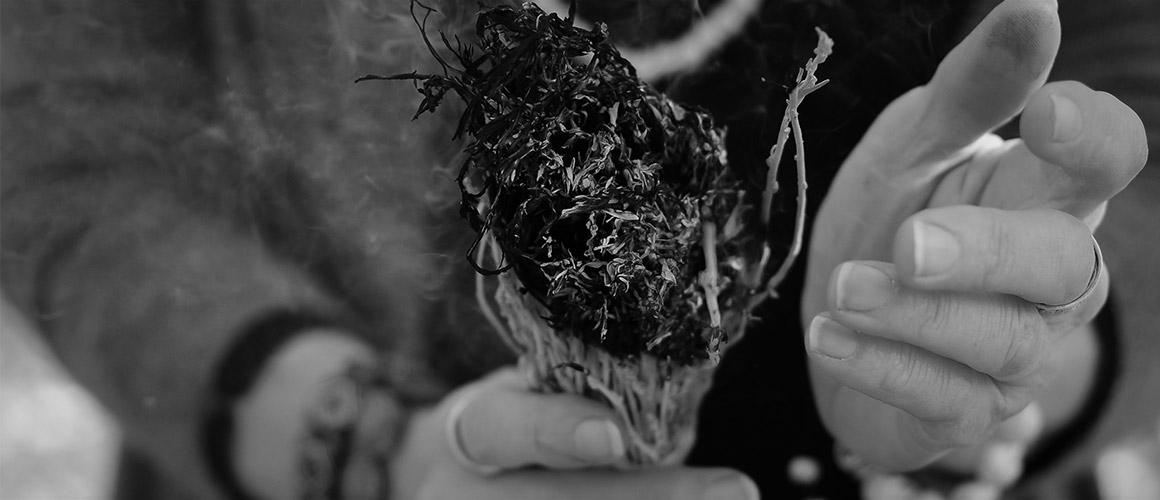 Stock photograph of a woman burning sage