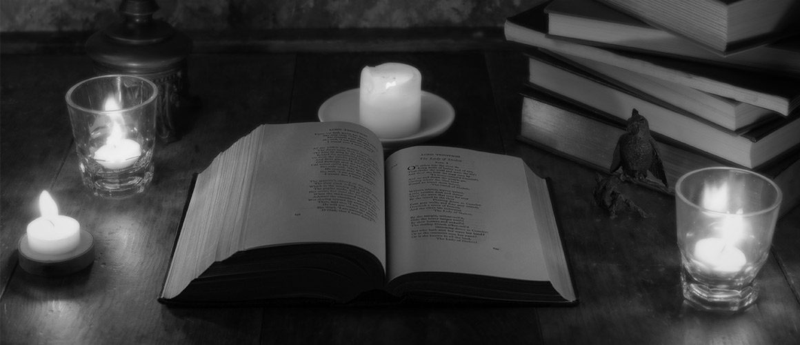 Photograph of books and candles.
