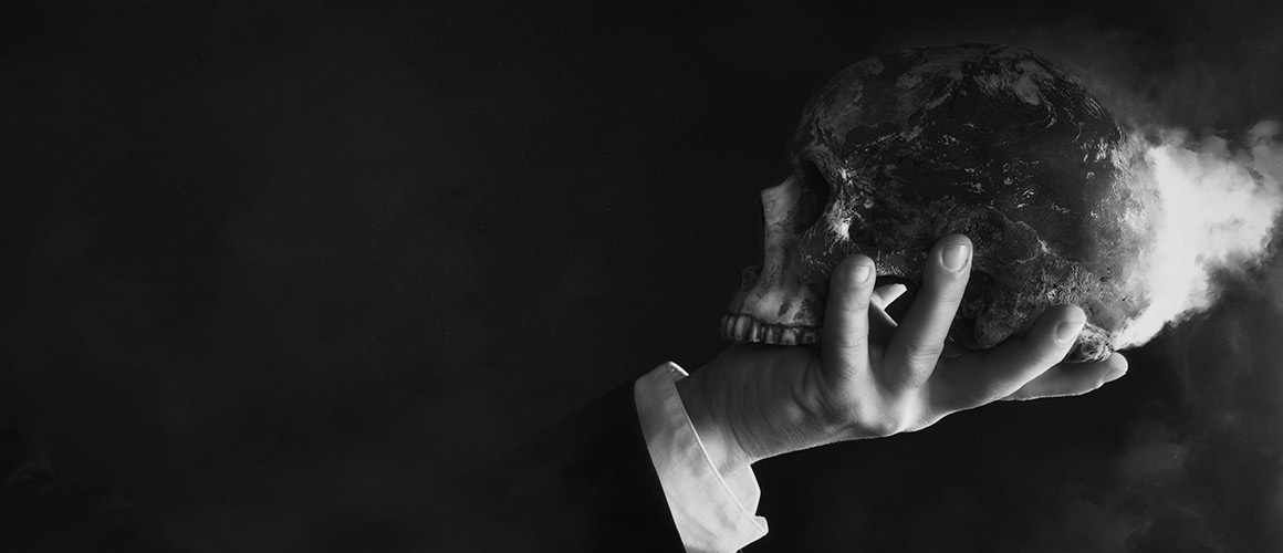 Stock photograph of a person holding up a skull.