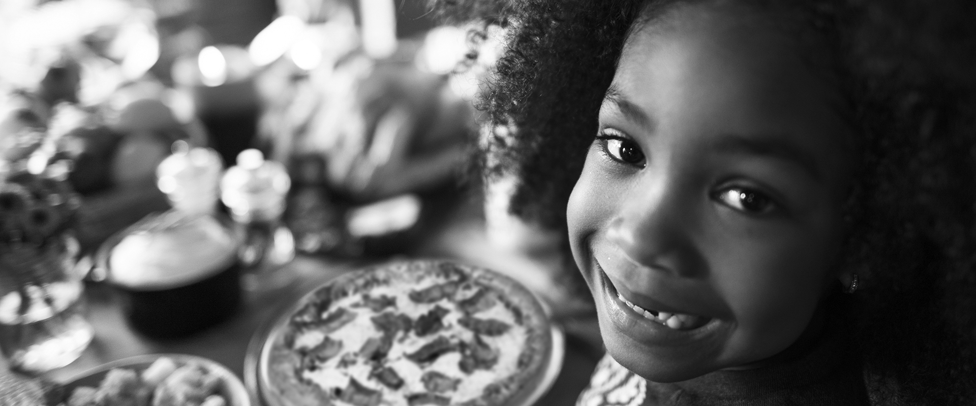 Photograph of child having pizza