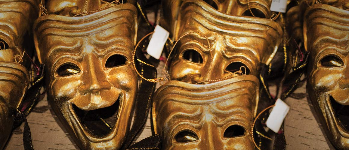Archival photo of theatrical masks.